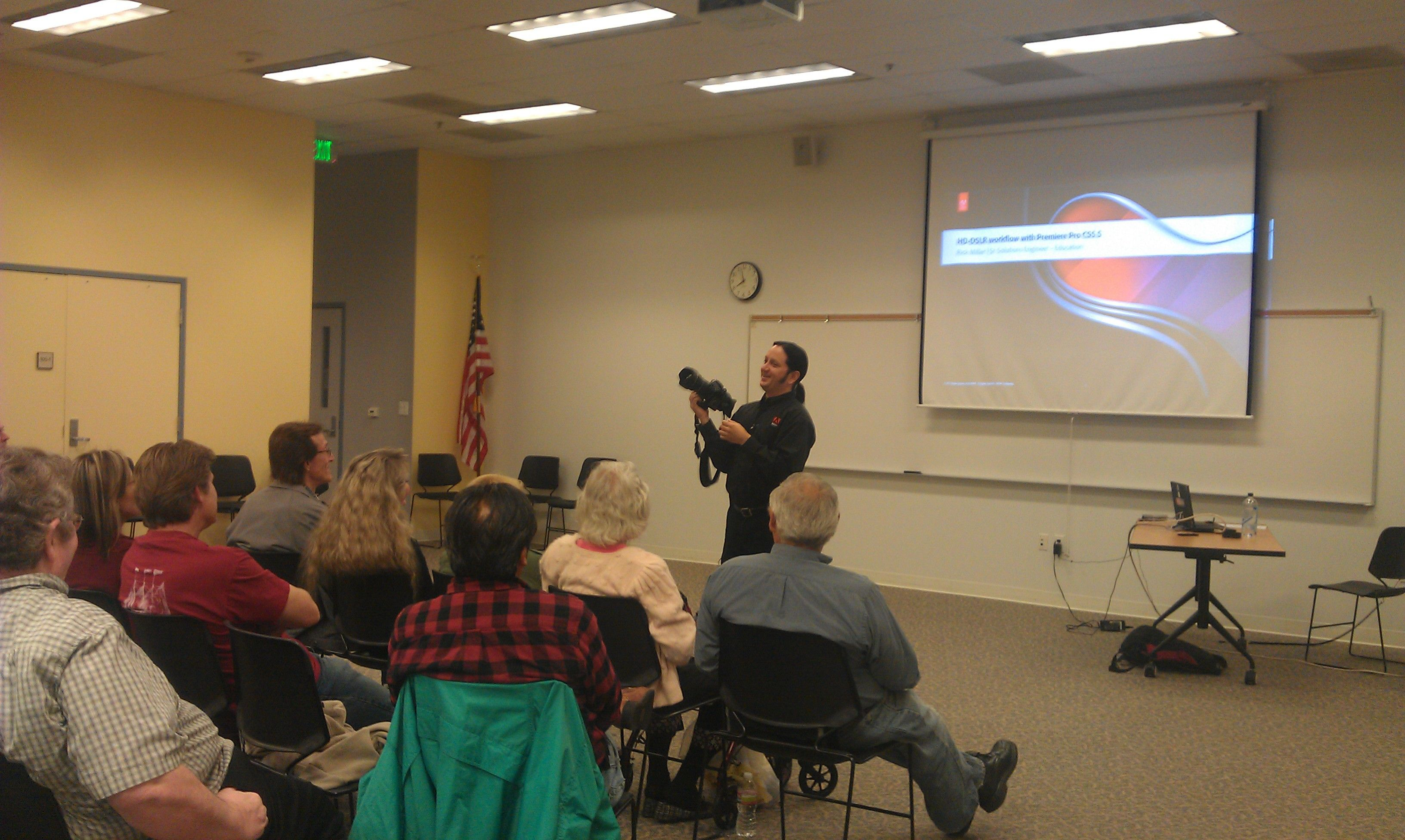 Certified Adobe Professional Demonstrating Camera Techniques at the Orange Education Center